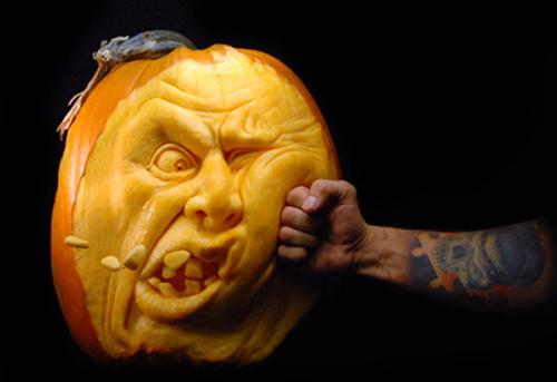 Pumpkin carving #2 is being punched.